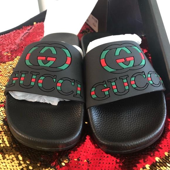 1bc6c0c7f82 Gucci logo rubber slide sandals